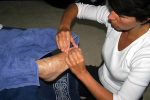 About Reflexology and Acupressure. working on feet